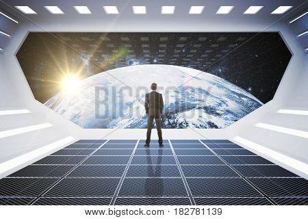 Back view of businessman in spaceship looking at globe.  3D Rendering
