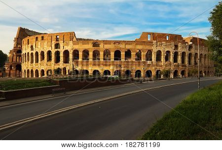 is an oval amphitheatre in the centre of the city of Rome Italy. Built of concrete and sand it is the largest amphitheatre ever built.
