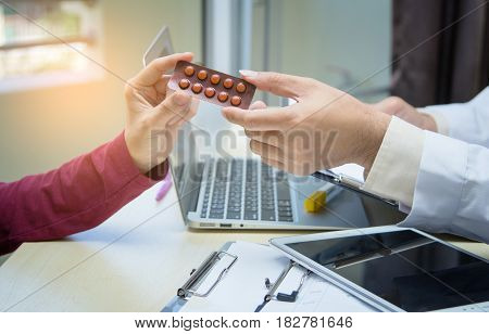 Medicine Doctor Hand Giving Or Showing Medications To Patient.