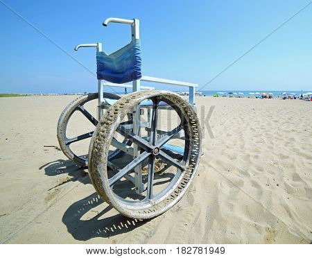 Special wheelchair with big steel wheels to go on the sand