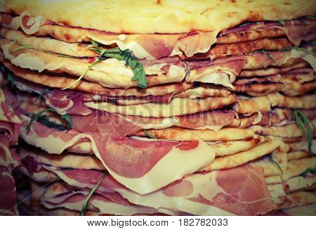 Piles Of Tortillas With Ham And Arugula For Sale