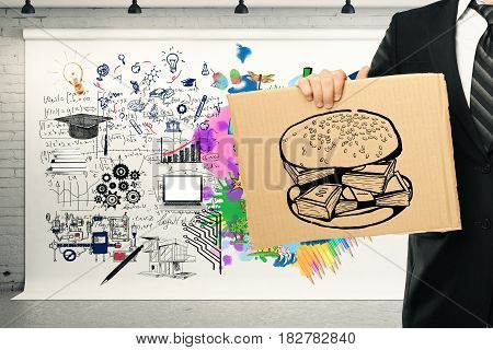 Creative and analytical thinking concept. Close up of businessman's hand holding poster with burger sketch in interior with sketch. 3D Rendering