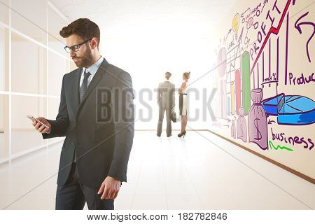 Handsome young businessman using smartphone in interior with colorful sketch on wall. Technology concept. 3D Rendering