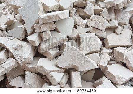 A pile of stones. Unusual background from broken gray bricks, construction rubbish