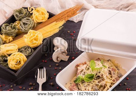 Spaghetti carbonara with champignon mushrooms and cheese parmesan