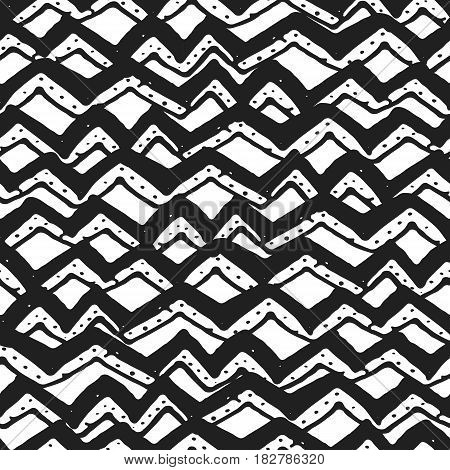 Decorative hand drawn seamless pattern. Endless ornament with black ink doodles on white backdrop. Hand painted stylish background for fabric, wrapping, packaging paper, wallpaper