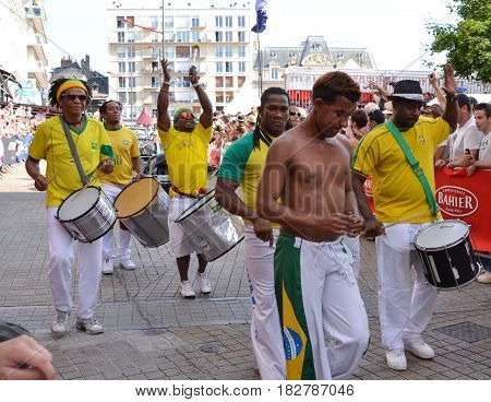 LE MANS FRANCE - JUNE 13 2014: Brazilian man dancing at a parade of pilots racing in Le mansFrance.