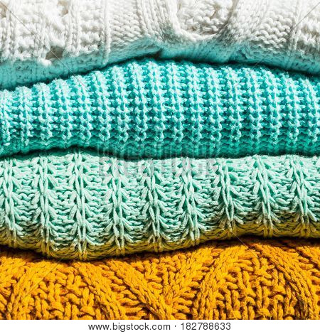 Stack of Cozy Cotton Knitted Sweaters, Close Up Image