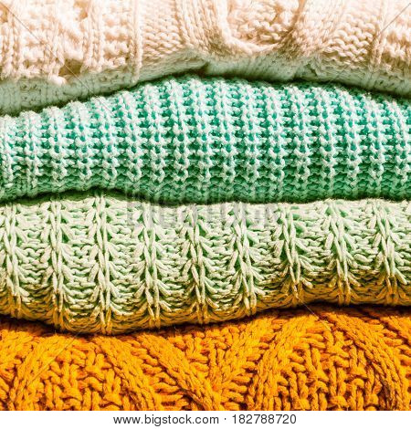 Stack of Cozy Cotton Knitted Sweaters, Toned Image, Close up