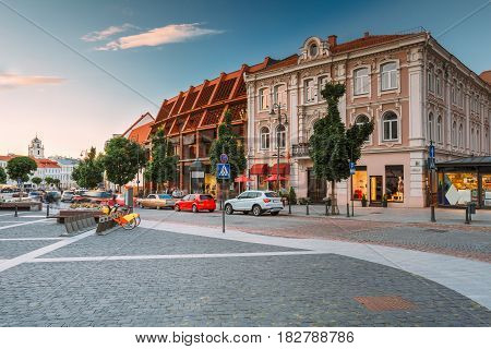 Vilnius, Lithuania. View Of Spacious Rest Zone On Didzioji Street, The Ancient Showplace In Old Town With Outdoor Cafe In Summer Day Under Blue Sky With Clouds.