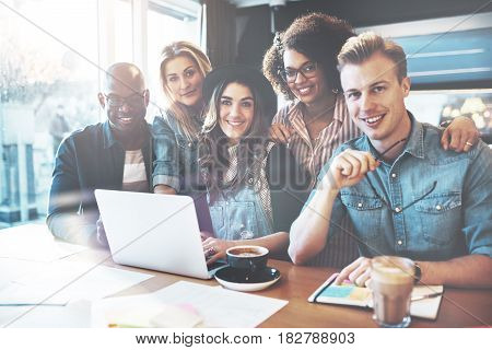 Smiling Group Of Coworkers In Small Office