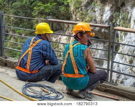 Workers At An Edge Of A  River
