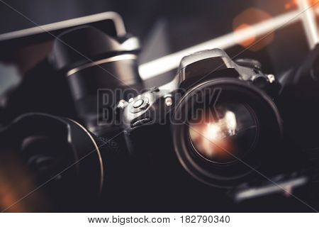 Professional Digital Photo Gear. Pro Digital Interchangeable Lenses Camera. Photographers Equipment.