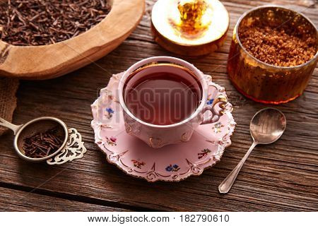 kukicha tea served pink vintage cup on wooden table board