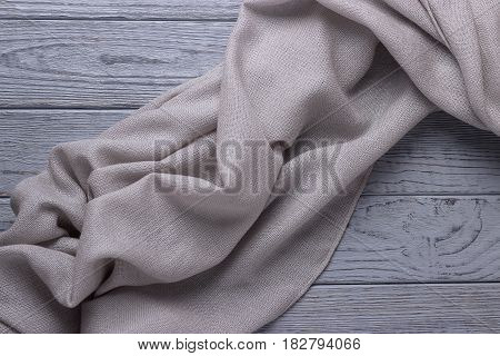 Soft gray shawl on a wooden background