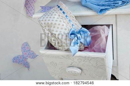 Beautiful baby girl hat with a blue satin bow and decorative butterflies