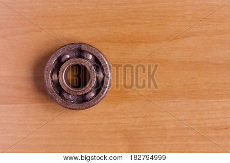 Metal copper bearing for heavy industry on wooden background