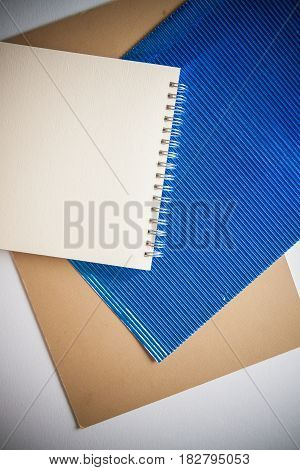 stylish vintage background with various textures and blue fluttered paper copy space for text
