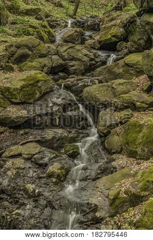 Waterfall near Moravany village in spring green day