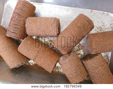 Renewable wooden briquettes for heating Alternative fuel eco fuel bio fuel.