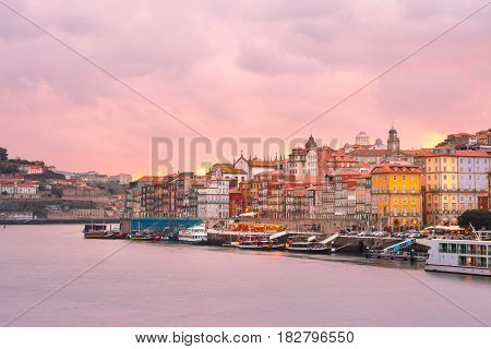 Ribeira and Old town of Porto with mirror reflections in the Douro River at sunset, Portugal, Portugal.