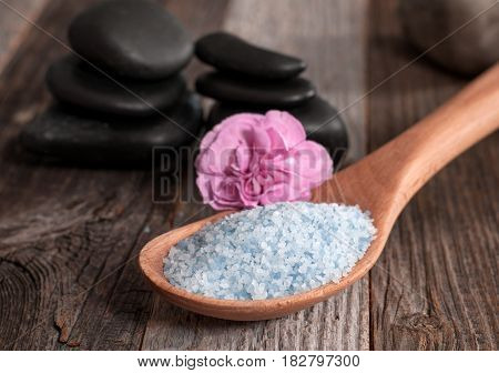 Wooden Spoon Full Of Sea Salt On Wooden Background