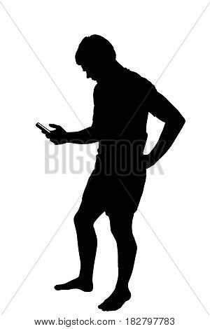 Full Length Side Profile Portrait Silhouette Of Teenage Boy Texting On Smart Phone