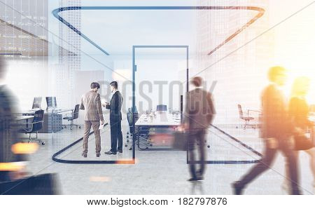 Rear view of businesspeople standing and passing by a conference room with glass walls in a busy office. Toned image double exposure