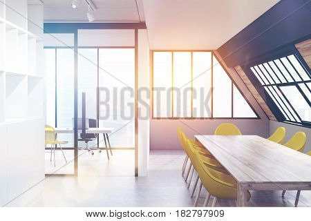 Attic conference room interior with a long wooden talbe surrounded by yellow chairs and a bookcase on the left. 3d rendering toned image.