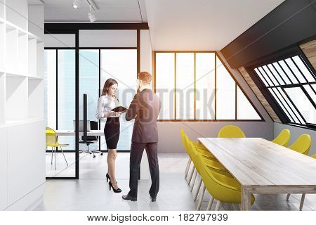 Man and woman are dicussing work issues in an attic conference room interior with a long wooden talbe surrounded by yellow chairs and a bookcase on the left. 3d rendering toned image.
