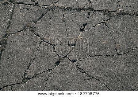 Asphalt with cracks. cracked asphalt road surface texture.