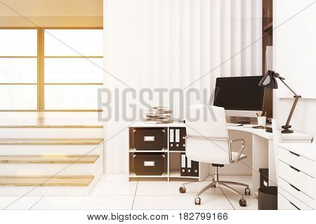 Home office interior with a computer standing on a white desk a large window and a small flight of stairs leading to it. 3d rendering mock up toned image