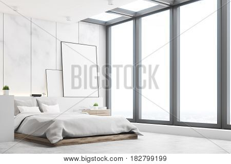 Side view of a bedroom with marble walls a double bed and two blank posters to the right of it. 3d rendering mock up