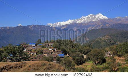Gurung village Ghale Gaun and snow capped Annapurna range Nepal. Popular travel destination.