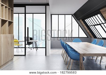 Attic conference room interior with a long wooden talbe surrounded by blue chairs and a bookcase on the left. 3d rendering.