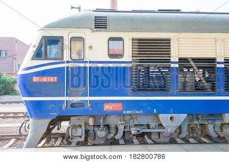 Heilongjiang, China - Jul 24 2015: China Railways Df11 Diesel Locomotive In Mudanjiang Railway Stati