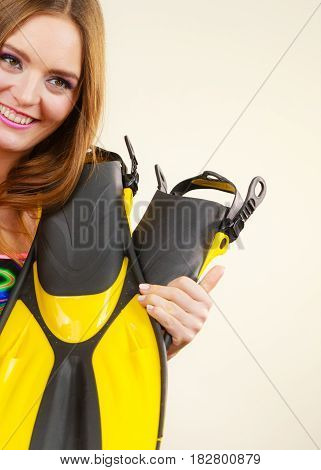 Woman In Swimsuit Holds Flippers Having Fun