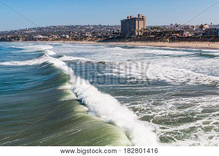 Waves crash on the beach at Pacific Beach in San Diego, California.
