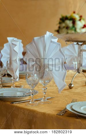 Place Setting At Laid Restaurant Table In Beige Colours