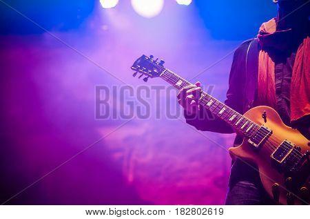 guitarist on stage - summer music festival