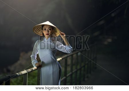 Beautiful woman with Vietnam culture traditional vintage styleHoi an Vietnam