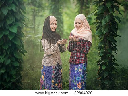 Young Woman Muslim Praying in Thailand countryside area