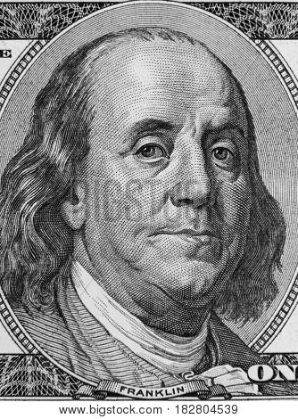 Closeup of Benjamin Franklin on hundred dollar American banknote