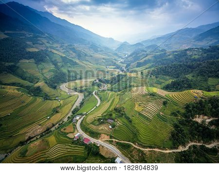 Mountain road in beautiful valley Mu Cang Chai YenBai Vietnam. Rice fields prepare the harvest at Northwest Vietnam.Vietnam landscapes.