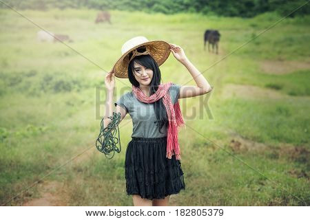 Thai local pretty woman working at farmland