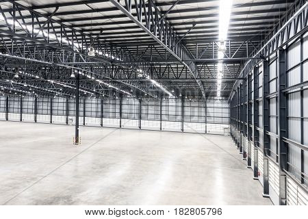Interior of empty industrial warehouse, Thailand, Asia