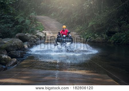 Woman on the ATV Bike on the mountains road