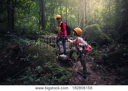 Teamwork couple hiking help each other trust assistance