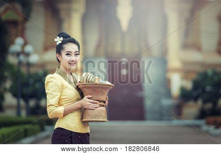 Beautiful girl in Laos costume.Lao traditional dress of a beautiful woman