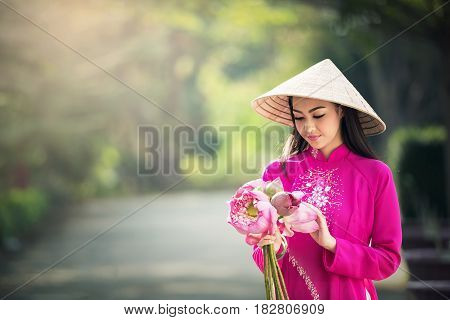 Beautiful woman with Vietnam culture traditional Ao dai is famous traditional costume